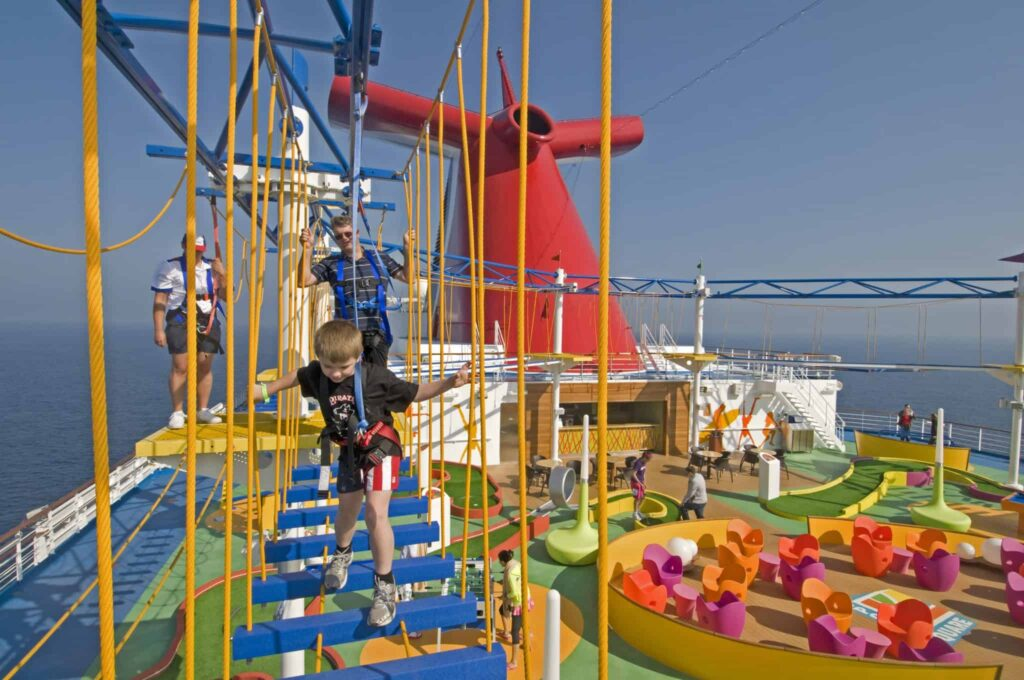 Guests on board the new Carnival Magic try out SkyCourse, the first-ever ropes course at sea in which participants can traverse suspended cables with views 150 feet to the sea below. The course is part of an expansive outdoor recreation area on the ship called SportSquare.